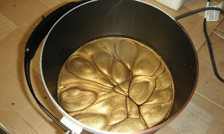 A close up of a metal pan on a stove