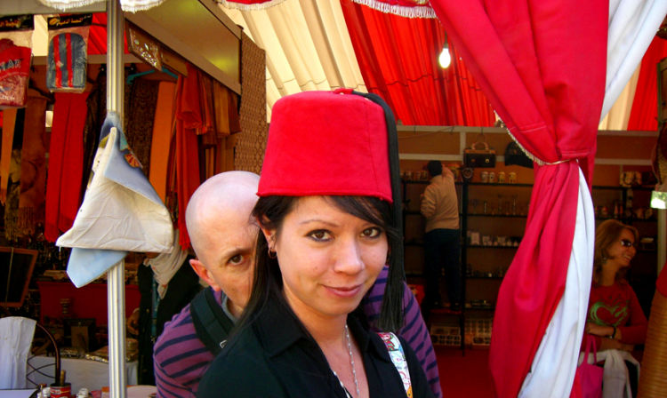 A person wearing a red hat