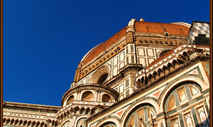 A large building in the background with Florence Cathedral in the background
